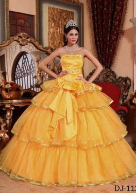 2014 Fashionable Golden Puffy Strapless Bow Quinceanera Dress with Ruffled Layers