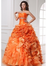 Orange Sweetheart Quinceanera Gown with Beading and Rolling Flowers