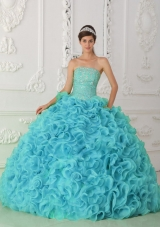 Strapless Organza Beading Ball Gown Fashionable Quinceanera Dress in Blue,�Strapless dresses are one of the sexier styles on the market today. They show just enough skin to be classy without beingtoo revealing. The bodice is is accented with scattered crystals and beadings.The full skirt features rolling flowers,which makes the dress very luxurious.