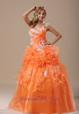 Appliques Decorate Up Bodice Sweetheart Dress for Quince,Fairytale-inspired dresses will always be popular because every girl dreams of being a princess. This orange quinceanera dress is the stunning example.It features a strapless bodice with a sweetheart neckline and some scattered embroidery.The ruching on the bodice and the chic flowers in the waist area are so exquisite and dainty that can also defines your slim curve.The A-line skirt features two tiers.The top one is comprised of lots of ruffles, ribbons and flower ,while the underskirt is made from the stunning fabric.The lace up back secures the dress and completes this wonderful design. You will be sure the shimmering star in the party.