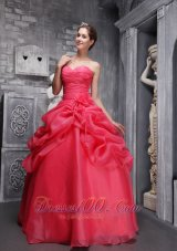 Sweetheart Coral Red Quinceanera Dress Pick-ups,Fairytale-inspired dresses will always be popular because every girl dreams of being a princess. This red quinceanera dress is the stunning example.It features a strapless bodice with a sweetheart neckline and some scattered beadings.The ruching all over the bodice and the chic flowers in the waist area are so exquisite and dainty that can also defines your slim curve.The A-line skirt features two tiers.The top one is comprised of lots of ruffles, ribbons and flower ,while the underskirt is made from the stunning fabric.The lace up back secures the dress and completes this wonderful design. You will be sure the shimmering star in the party.  Silhouette: Ball Gown Neckline: Sweethrart Waist: Dropped Hemline/Train: Floor-length Sleeve Length: Sleeveless Embellishment: Beading, Ruch, Hand Made Flowers Back Detail: Lace-up Fully Lined: Yes Built-In Bra: Yes Fabric: Organza Shown Color: Coral Red(Color & Style representation may vary by monitor.) Occasion: Prom, Formal Evening, Quinceanera, Military Ball Season: Spring, Summer, Fall, Winter