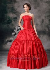 Strapless Ruch Red Quinceanera Dress 2013,Deck yourself out in supreme sophistication with this ravishing flirt pleated gown! Its sleek strapless neckline is coated in nothing but flatters your bust wonderfully. The skirt flares all the way to the floor and is all along punctuated with three layers of Luxurious and Fashionable pleats. By the way, a wonderful unskirt makes the skirt puffy enough. Zipper up completes the look perfectly.  Silhouette: Ball Gown Neckline: Strapless Waist: Fitted Hemline/Train: Floor-length Sleeve Length: Sleeveless Embellishment: Ruch Back Detail: Zipper-up Fully Lined: Yes Built-In Bra: Yes Fabric: Taffeta Shown Color: Red(Color & Style representation may vary by monitor.) Occasion: Prom, Formal Evening, Graduation, Celebrity, Military Ball Season: Spring, Summer, Fall, Winter