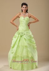 Yellow Green Folwers and Ruching Dress for Quinces,Make yourself the centerpiece of your party when you wear this ravishing ball gown dress. The strapless top features a sweetheart neckline, and pleated bodice embellished with delicate beading. The top layer of the impressive ball gown skirt is gathered, and a bouquet of matching flower accents the side.A lace up corset style closure in the back secures the dress in place.A lovely dress for any occasion!