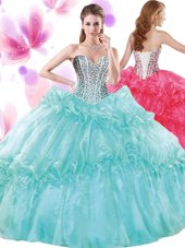 Turquoise Organza Lace Up Quinceanera Gowns Sleeveless Floor Length Beading and Pick Ups,Silhouette: Ball GownsNeckline: sweetheartSleeve Length: sleevelessHemline/Train: floor lengthBack Detail: lace upEmbellishment: beading,pick upsFabric: organzaShown Color: turquoise(Color & Style representation may vary by monitor.)Occasion: military ball,sweet 16,quinceaneraSeason: spring,summer,fall,winterFully Lined: YesBuilt-In Bra: Yes